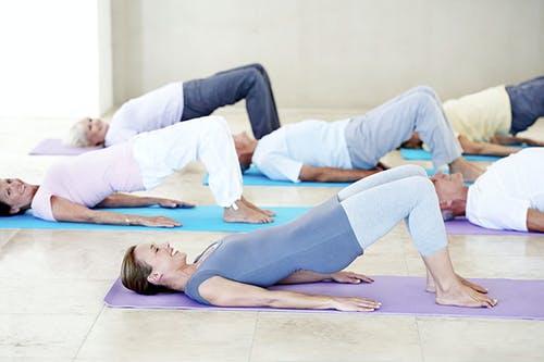 Pilates class doing bridge exercise.jpg